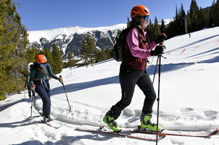 two women skiing uphill