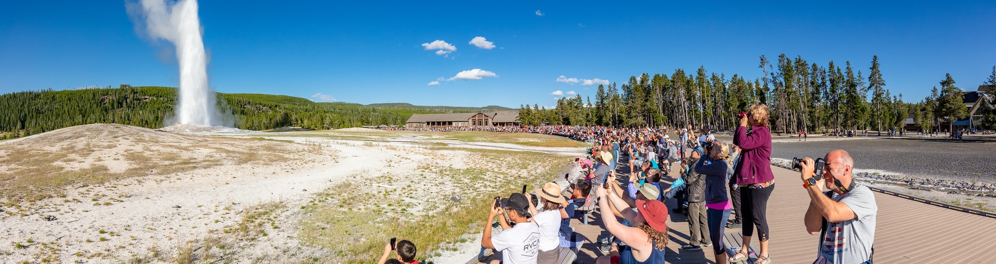 People watching an Old Faithful Eruption panorama
