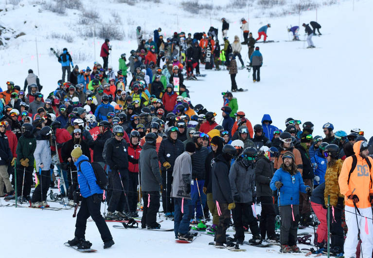 people wait in long lift line to ski