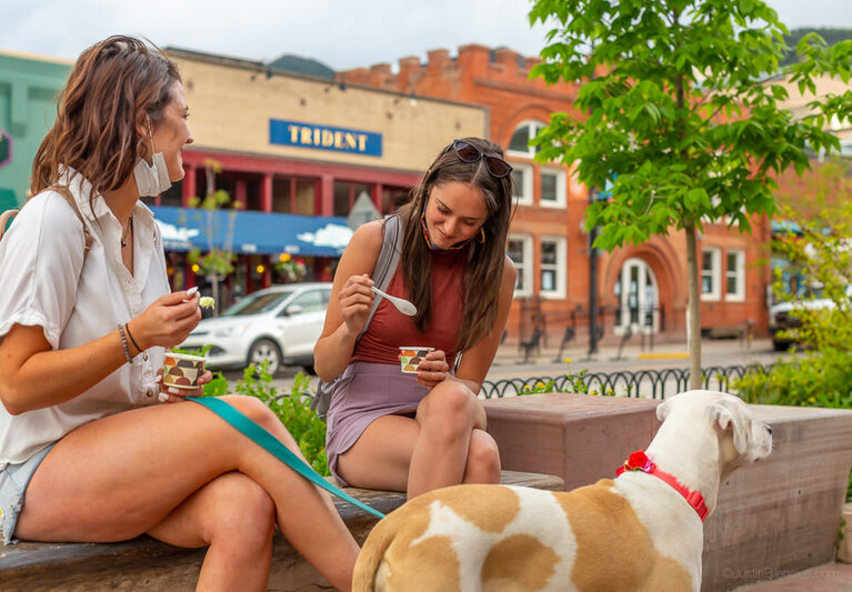 People eating ice cream downtown